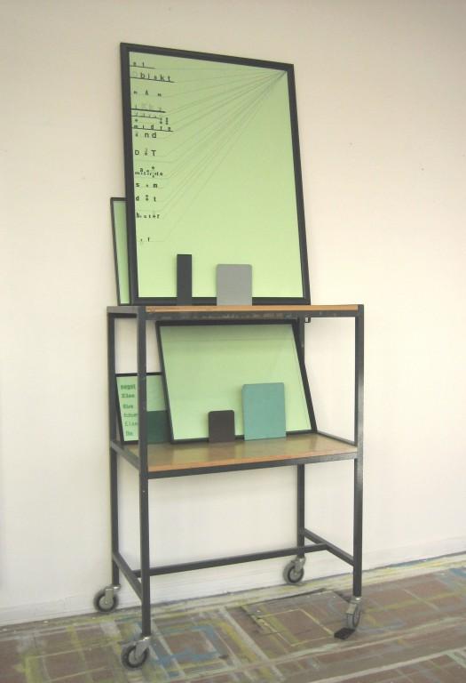 3 Noget Else (2016) Letraset, Tusch, fotokopi på grunderet papir i trærammer og bogstøtter på mobilt bord. 224x85x53cm.